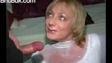 A bride in white gets a white cum bath